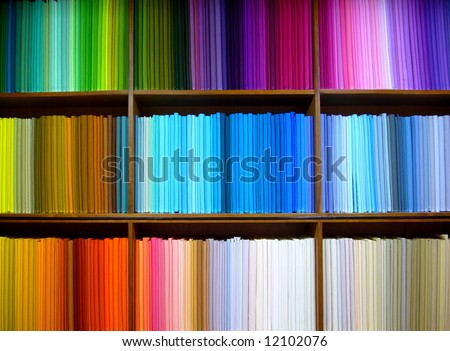 Bolts of colored cotton arranged on display in a fabric shop in Delhi, India - stock photo