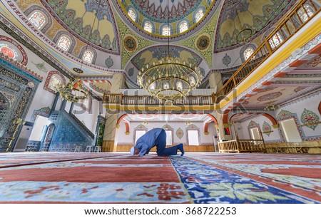BOLU, TURKEY - SEPTEMBER 09: Muslims preparing during the prayer Tasgesti new Mosque on September 09, 2015 in Bolu, Turkey. Prayer is a prayer that Muslims do five times a day. - stock photo