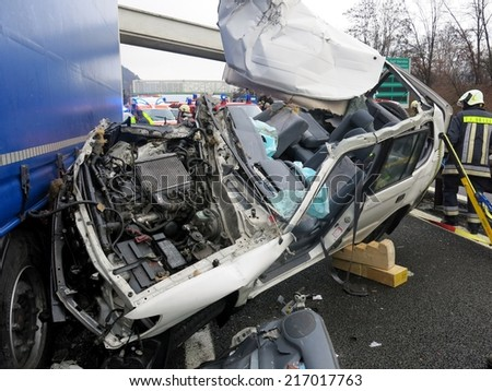 BOLZANO, ITALY - APRIL 16, 2014: Very hard collision between cross-country vehicle and lorry truck. Accident with truck and car, injured motorist on highway road on Bolzano, April 16, 2014 - stock photo