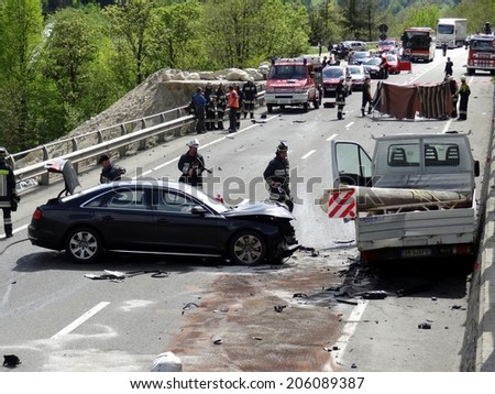 BOLZANO, ITALY - MAY 6, 2013: Multiple car crash accident after a frontal collision between two cars and Van on the road in Bolzano on May 6, 2013 with intervention of paramedics and firefighters - stock photo