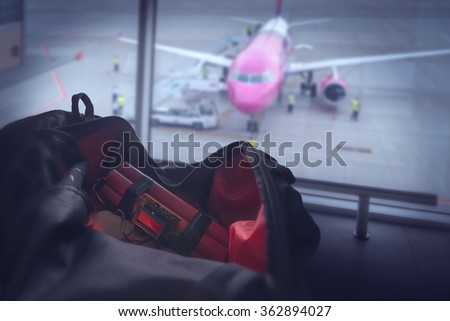 bomb and bag in airport - stock photo