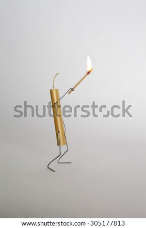 Bomb holding lighted stick - stock photo