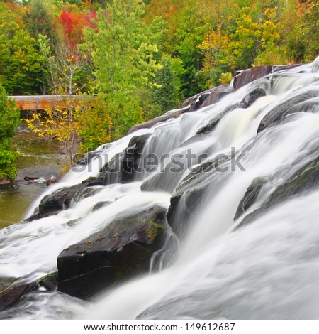 Bond Falls Scenic Area on an autumn day in the northwoods of Michigan - stock photo