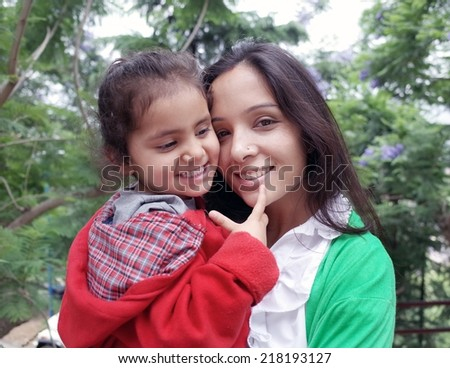 Bonding of love between mother and daughter. - stock photo