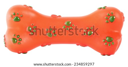 Bone rubber toy for dogs orange with green paws - stock photo