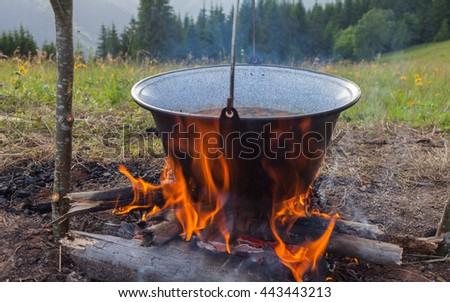 Bonfire and bowler - stock photo