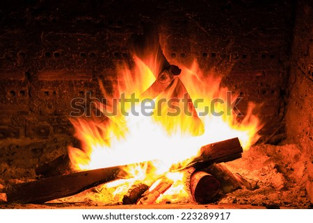 bonfire and flames in a fireplace - stock photo