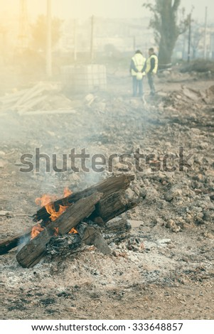 Bonfire at the construction site. Vintage style. - stock photo