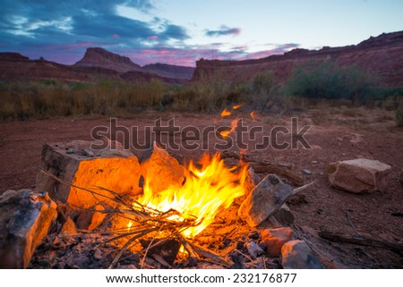 Bonfire on the bottom of the canyon after Sunset Utah Landscape - stock photo