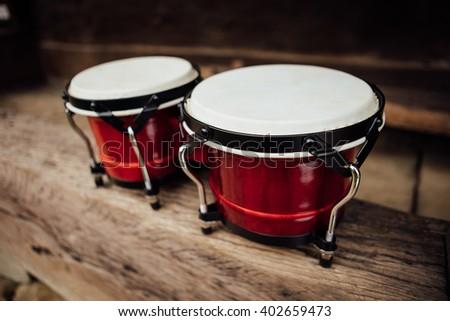 bongo drums on old wood plank - stock photo