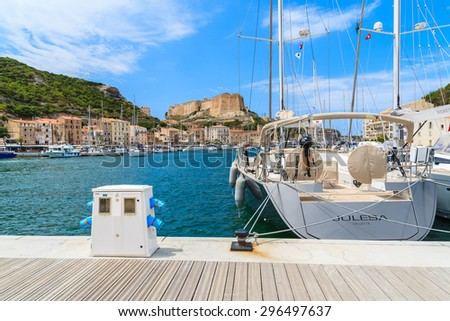 BONIFACIO PORT, CORSICA ISLAND - JUN 23, 2015: luxury yacht boat anchoring in Bonifacio port which is famous town on south coast of Corsica island and is major tourist attraction. - stock photo