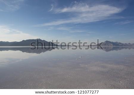 Bonneville Salt Flats International Speedway. Mystical reflection of desert mountains in sunset water - stock photo