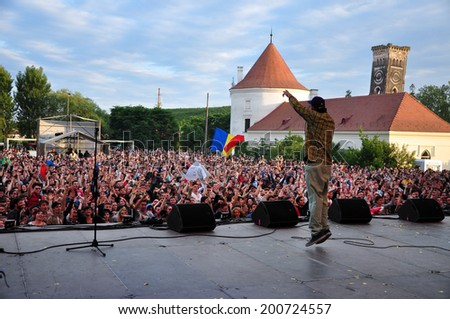 BONTIDA - JUNE 22: Suie Paparude performs live at the main stage of the Electric Castle Festival at June 22, 2014 in the Banffy castle in Bontida, Romania  - stock photo