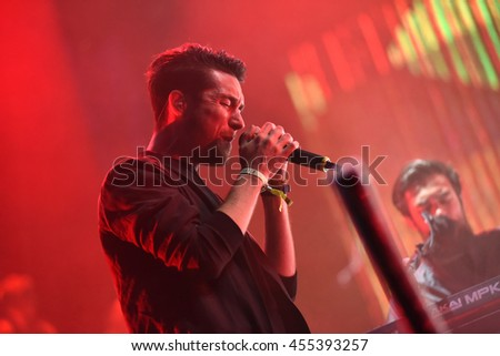 BONTIDA, ROMANIA - JULY 17, 2016: Singer Dan Smith of English band Bastille singing during a live performance at Electric Castle festival - stock photo