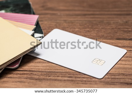 Book account bank with blank credit business card on office wooden table. - stock photo