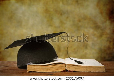 book and background Graduation - stock photo