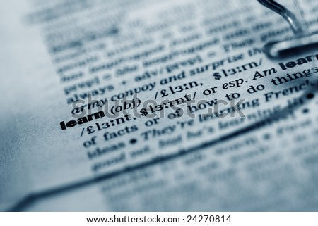 """Book and glasses with """"learn"""" word in focus. Shallow DOF photo - stock photo"""