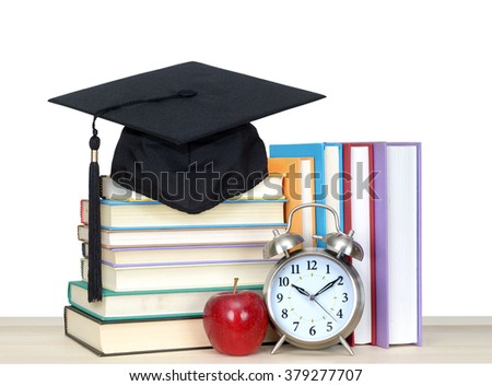 book and graduation cap with clock isolated on white - stock photo
