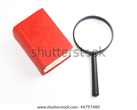 Book and magnifying glass isolated on the white background - stock photo