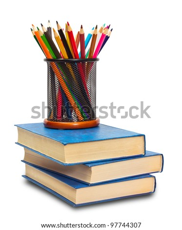 Book and pencils on white - stock photo