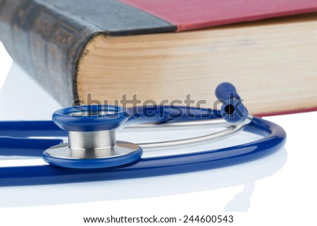 book and stethoscope, symbolic photo for bungling doctors errors and expertise - stock photo