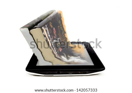 Book and tablet computer - stock photo
