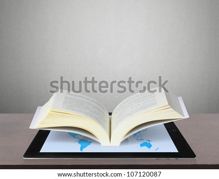 Book and tablet computer  model - stock photo