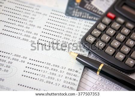 Book bank, credit cards, the calculator, a ball pen. Business finance concept - stock photo