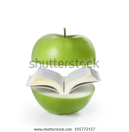 book green on apple on a white background - stock photo