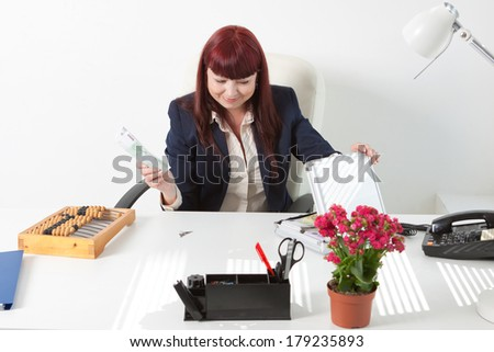 book-keeper with a lot of euros - stock photo