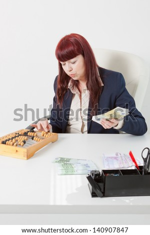 book-keeper with a lot of money - stock photo