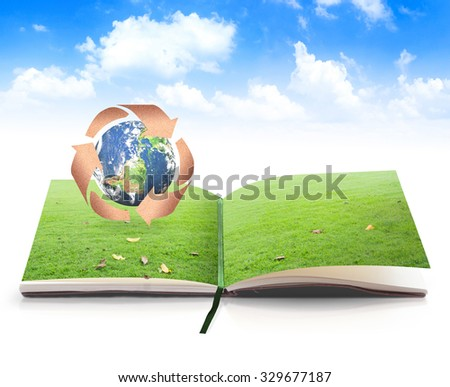 Book of nature for recycle arrow symbol made of old paper texture protecting earth globe on blue sky background. Recycle icon: world environmental concept. Elements of this image furnished by NASA. - stock photo