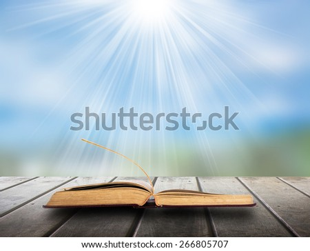 Book of nature on wood floor - stock photo