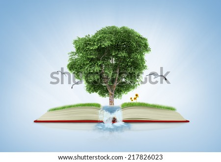 book of nature with grass and tree growth on it over white blue background - stock photo