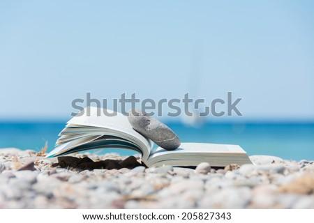 Book on the beach - stock photo
