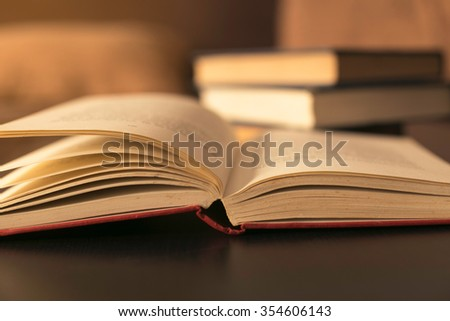 book on the desk against book - stock photo