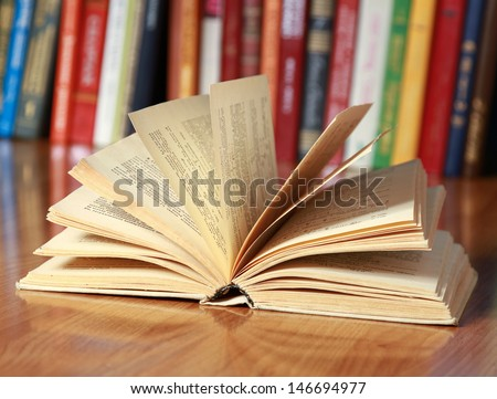 book on the desk against books - stock photo