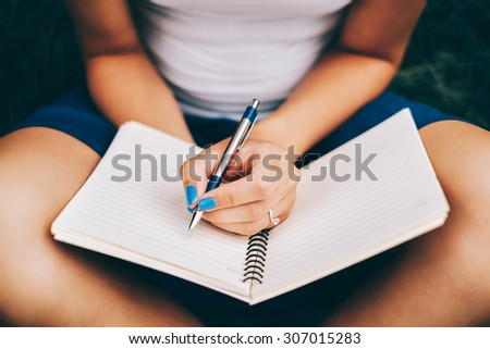 Book on women's hand - stock photo