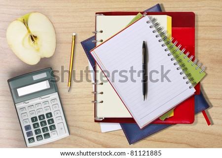Book, pen on wood - stock photo