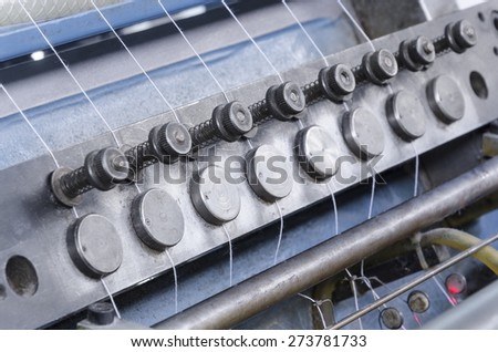 Book print production line. Offset print stitching machine threads.  - stock photo
