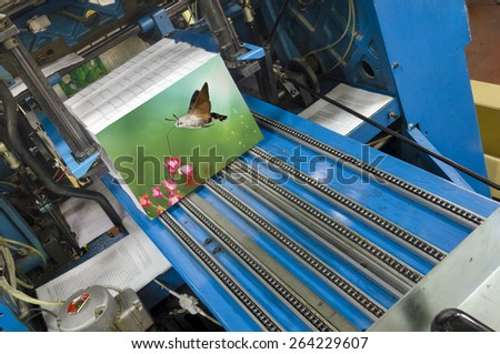 Book production line in modern print house wide shot - stock photo