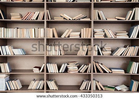Book shelf with many books - stock photo