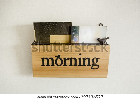"""Book shelf with wording """"Morning"""" - stock photo"""