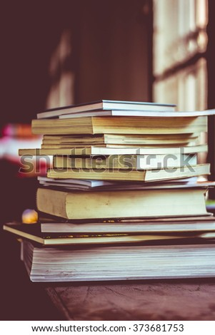 book stack with dark blurred background - stock photo