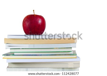 book stack with fresh red apple on top in white background - stock photo