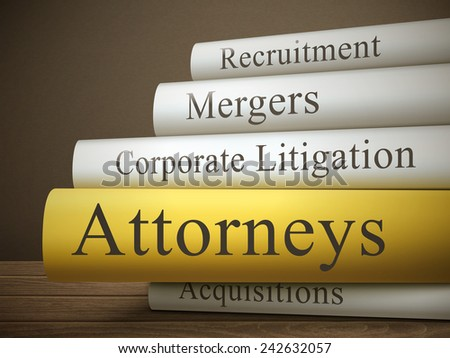 book title of attorneys isolated on a wooden table over dark background - stock photo