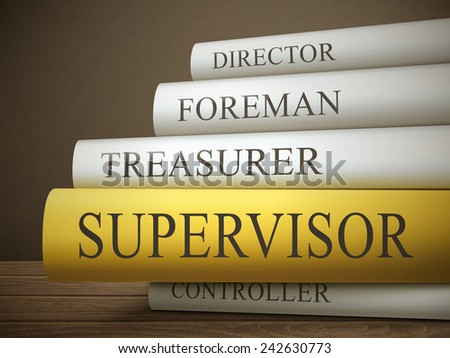 book title of supervisor isolated on a wooden table over dark background - stock photo