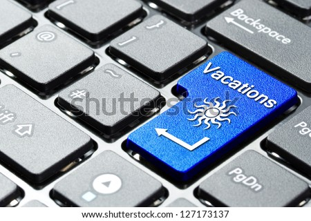 Book vacation button on the computer keyboard - stock photo
