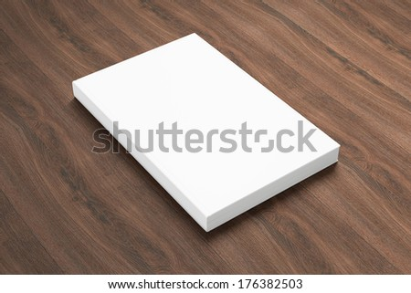 Book with blank cover isolated on wooden background - stock photo