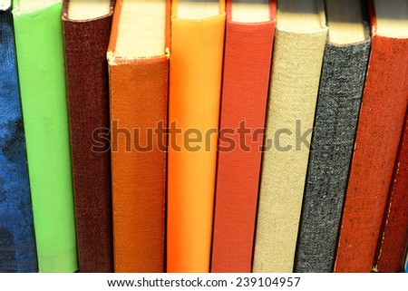 Book with books in shelf - stock photo